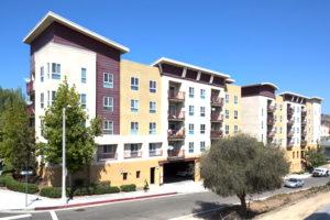 Castelar Exterior with balconies, sidewalk, and street